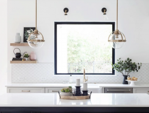 White kitchen with a square picture window over the sink